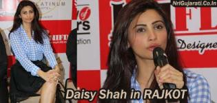 Daisy Shah at INIFD Rajkot New Building Inauguration in Knee Length Black Skirt n Checkered Shirt