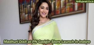 Madhuri Dixit in Light Lemon Colour Saree Photos at PN Gadgil Jewellery Store Launch in Indore India